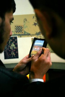 smart phone being used to research information in a museum